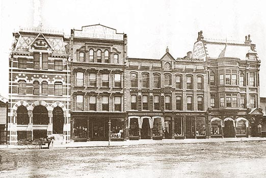 circa 1885, store building at far right
